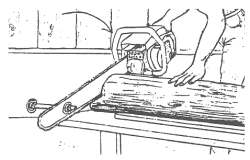 Using a chain saw as a chop saw for squaring off logs.  The bolt and handle must be equal distance from the wall (very important).  The tapered end of the log is shimmed to make the imaginary centerline of the log parallel with the level bench.