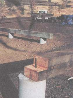 The new foundation is a grid of 10x10 timbers resting on 14'' sonotubes with underground footings.  Shown here, a half-lap joint is ready to receive its mate
