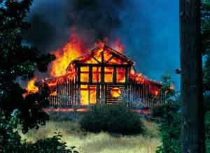 The first log home burns on June 29, 1995.
