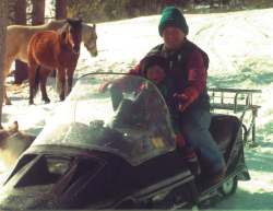Two stages of emergency traavel - snowmobile and horse.  Survival kits and tools are stowed safely onboard.