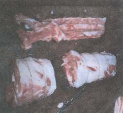 Figure 10.  Rolled poark roasts and the bone they came from.