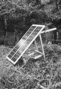 The original installation - two modules on a homemade cart to power a pump in the spring tank
