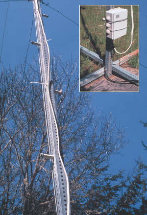 Foot pegs facilitate toer climbing.  UV-rated electrical cable is cable-tied to the tower. Inset: An LCB mounted at the tower's base assists the pump in early morning startup or in winter sun.