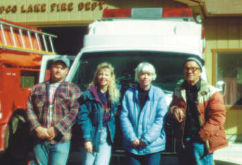 Standing in front of the emergency response vehicle are, from left, Phil Reynolds, Sue Tickle, Paula Wigington, and Chief Murrel Wigington (Frank Tickle photo)