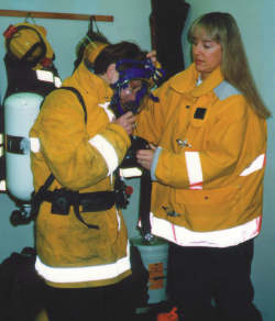 Judy Finses, left, and Pam Morford train with a SCBA (Self Contained Breathing Apparatus)