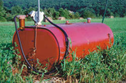 Salvaged 275 gallon horizontal fuel tank with hand fuel pump and filter.  This type of pump is suited for all fuels; current use is for diesel fuel.