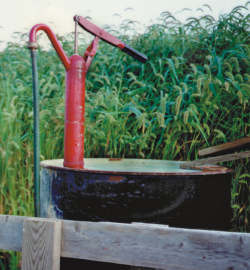 Thirty dollar drum pump mounted on a 55-gallon drum of kerosene. This type of piston pump is not suitable for gasoline.