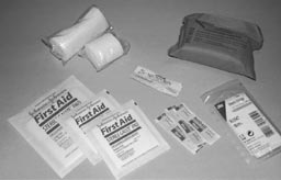 Your first aid kit should include materials to treat lacerations and bleeding. Some of the materials you will want include sterile gauze pads, pressure dressings, rolled gauze bandages, wound closure strips, antibiotic ointment, and Band-Aids.