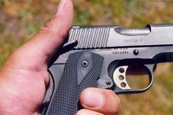 For left-handed shooting, you want an ambidextrous gun. Left thumb manipulates the ambidextrous manual safety of Kimber Custom II .45 auto.
