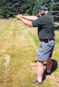 Get good training! Marty Hayes of Firearms Academy of Seattle (www.firearmsacademy.com) illustrates a strong firing stance with S&W's new SW1911 .45 automatic.