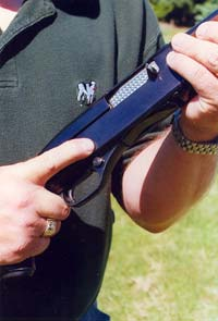 Finger should be clear of the trigger, the trigger guard, and even the safety when holding a firearm, until the shooter is in the act of intentionally firing the gun.