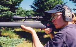 Good firearms safety. Active muffs over ear plugs give best protection. Shooting glasses are a must. Gila keeps her eyes open and on target as she intentionally presses the trigger.