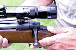 Note thumb position on the sliding top-tang manual safety, an ergonomic and ambidextrous feature that was a Savage exclusive in guns of its type at time of introduction.