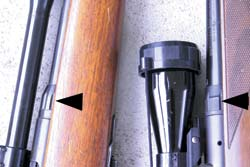 Collared lock-nut design where barrel meets receiver appeared on the old Savage Model 340 (left, with narrow WWII-era Weaver scope), before designer Brewer applied it to good advantage on the Model 110, right. (arrows)