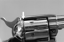On single action cartridge revolvers, empty chamber (arrow) should be visible from this angle, while cartridge heads are visible in lower chambers.