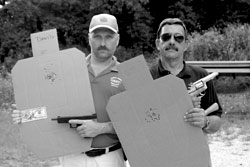 In defensive handguns, medium calibers will suffice with the right ammo and good hits. There are 60 timed 'combat match' shots on each of these targets. Left, former Midwest Regional Champion (Stock Service Pistol) Dave Maglio with Glock 9mm; right, former Midwest Regional Champion (Stock Service Revolver) Mas Ayoob with S&W .38 Special.