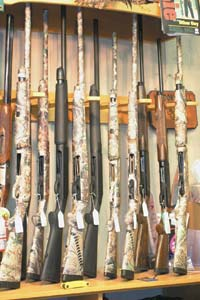 The majority of hunting and sporting shotguns in this gun shop display are semiautomatics, the kind Barack Obama has publicly stated he wants to ban.