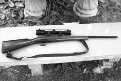 "A classic example of a ""sporterized"" bolt-action military surplus rifle. This 1916 Spanish Mauser's issue stock has been roughly reshaped to ""hunting"" style; bolt handle has been turned down to allow 3-9X variable power Bushnell scope; and rifle has been rechambered to modern, popular .308 Winchester cartridge."