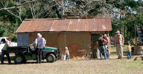 Family members young and old gather every year at the syrup house to make cane syrup.