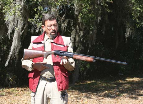 With one finger, Mas demonstrates balance point of Benelli 20-gauge.