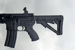 This Sabre Defense AR15 carbine has its collapsible stock closed, for its smallest-stature user...