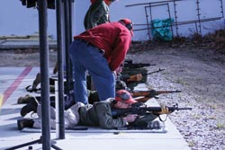 Prone is emphasized for precision shots. Here, in dry fire, we see two AR15s, a WWII Mosin-Nagant, and a Kalashnikov.