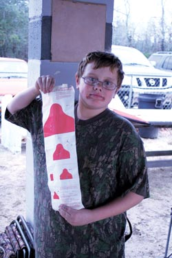"Young people are more than welcome at Appleseed, and attend for free. This young man has shot a fine ""redcoat"" target, and has even hit the postage stamp-size mark at 25 meters."