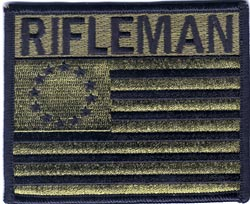 Appleseed's coveted Rifleman's Patch, equivalent of scoring Expert on an Army qualification course.