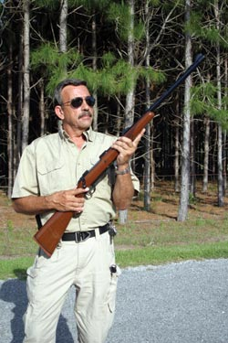 Massad Ayoob with his Ruger Model 77, caliber .458 Winchester Magnum. He credits its deterrent effect for his elephant-free property.