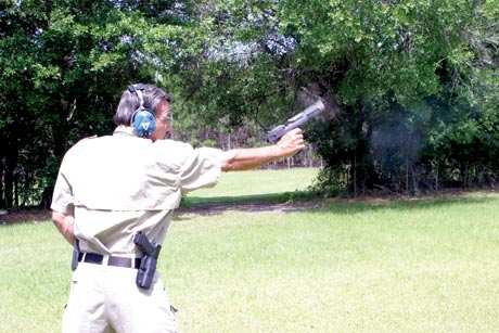 Recoil torques the wrist as Mas fires a Desert Eagle pistol, caliber .50 Action Express.