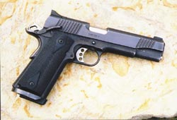 The 1911 .45 automatic remains the quintessential American combat handgun. This one is the excellent, affordable Kimber Custom II.