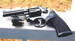 'Old-fashioned' service revolvers have the match-grade accuracy for surgical rescue shooting in capable hands. This is S&W's classic Combat Masterpiece .38 Special, with Remington +P 125 grain hollow points in a Safariland speedloader.