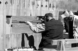 With a short 20'' barrel, shooting through a window (fox outside the chicken coop, crop destroyer in the garden situation) is easy for the shooter with a 12-gauge pump gun. Rich Edington demonstrates at a shooting match.