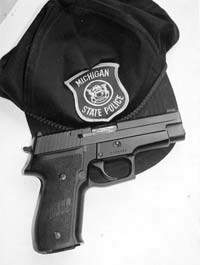 Worn in the open in a uniform holster, the SIG P226 carries 16 rounds of 9mm.