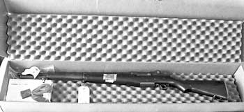 The M1 Garand as it appeared, fresh in its box. Notice, at left the accessories package which included a sling and a single en bloc magazine.