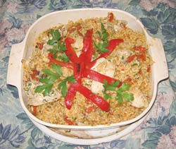Arroz con pollo. This Latin-style chicken and rice dish is the full-flavored cousin of American-style chicken and rice.
