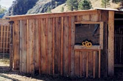 Our chicken coop/goat shed in Wolf Creek, Montana was built using salvaged materials.