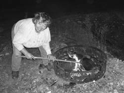 Jackie burns two of her cast iron pans in a fire to remove year's worth of crusted-on food and grease.