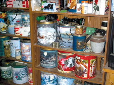 Large, colorful holiday popcorn tins keep dry foods, such as flour, sugar, rolled oats, and noodles, safe from insects and rodents.