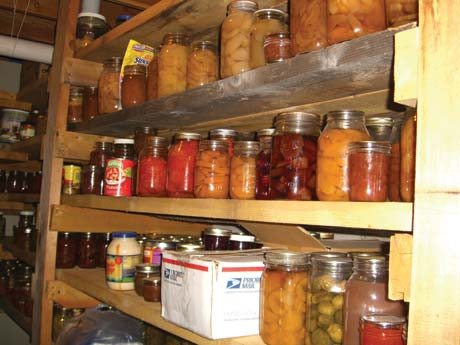 This big basement pantry has two-foot-deep shelves from floor to ceiling. I keep two years' worth of food here.