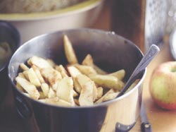 Toss fresh, sliced apples with flour, cinnamon, and sugar for a simple, tasty pie filling.