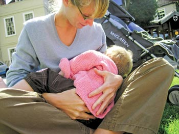The author breastfeeds 12-month-old Hannah; a year later she is still nursing. The World Health Organization now advises mothers to breastfeed their babies for at least two years, and to continue as long as mutually desired.