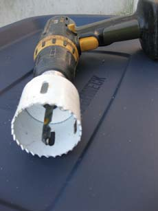 Use a 2-inch hole-cutting bit to cut two vent holes in the lid of your container, and one on each side toward the top.