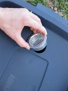 Insert 2-inch soffit vents in the holes. The vents will provide adequate air flow to the worms.