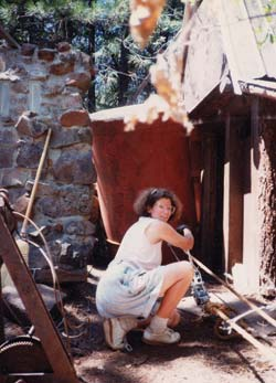 Lenie was unafraid of any type of work. She helped me drag a water tank in place for a gravity-fed water system.
