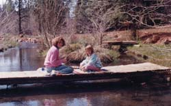 Spring Creek, like most country places, had lots of opportunities for quiet fun. Here, Annie and Lenie play cards on one of several foot bridges we built.