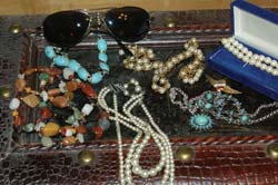 Collector pins, jewelry, and other accessories are always hot items on online auctions.