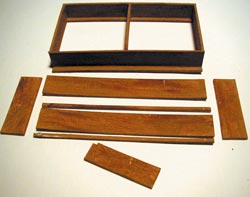 Here are parts of a box shelf, and an assembled box shelf unit. Parts should be stained or painted before assembly and touched up before installing. This kind of shelf is best for specific items such as books.
