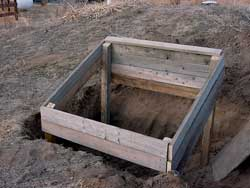The hotbed frame is constructed over a hole that will be filled with manure.