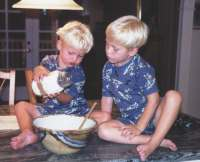 Christian and Nicholas mix up a batch of cookies in a jar.